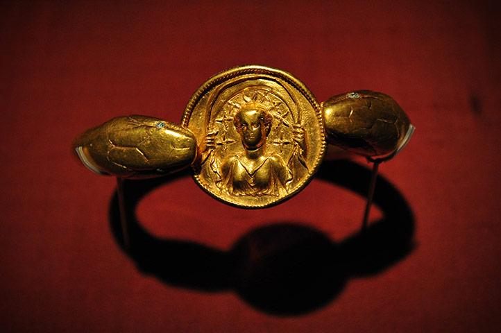Golden snake amulet