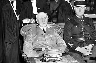 Marshal Henri Philippe Petain attends the opening of his trial in Paris on 23 July 1945