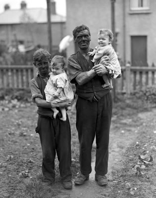 A miner and his family, Rhondda Valley, South Wales