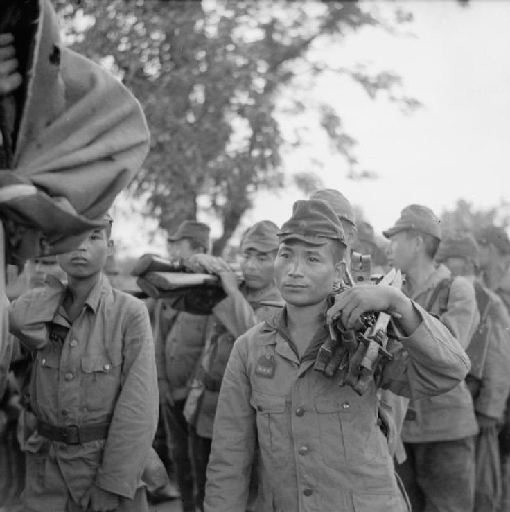 Gurkha Rifles (17th Indian Division) after surrendering at a railway bridge over the Sittang River in Burma.