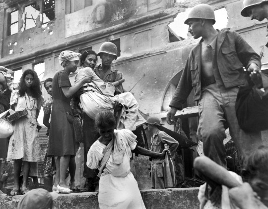 Filipino women are rescued from the Santa Clara Monastery in Manila by U.S. soldiers. The women had taken shelter in the monastery during heavy fighting of the Battle of Manila.
