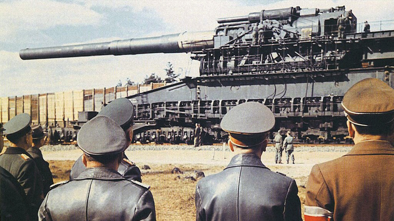 Hitler and generals inspecting the largest caliber rifled weapon ever used in combat, the Schwerer Gustav, 1941