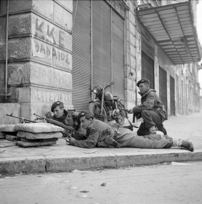 Paras_from_5th_(Scots)_Parachute_Battalion,_2nd_Parachute_Brigade,_take_cover_on_a_street_corner_in_Athens_during_operations_against_members_of_ELAS,_6_December_1944._NA20515