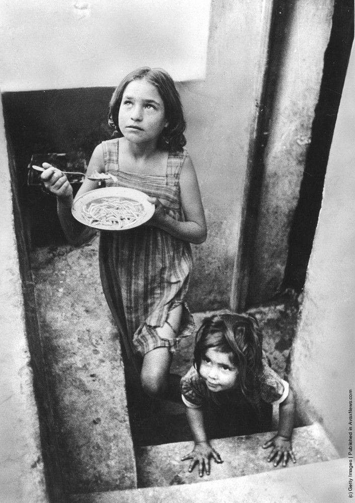 Refugee children in a filthy cellar at Piraeus during the Greek Civil War.