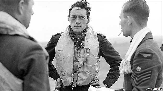 Squadron Leader B J E 'Sandy' Lane (centre), pictured here aged 23