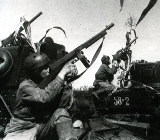 Soviet tank crewmen firing American lend-lease Thompson guns, WW2