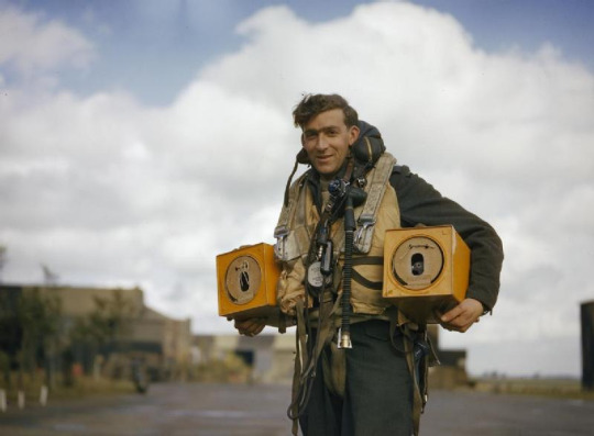 Avro Lancaster Crewman with homing pigeons, carried in Lancasters as a means of communications in the event of a crash, ditching or radio failure, 1942