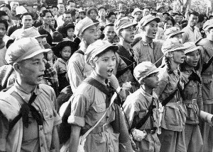 Communist soldiers from the East river unit, with among them several women, song an hymn to Mao Tse Tung glory as they arrive in Sham Chum, three kilometers north of Hong-kong britain's border 25 October 1949.