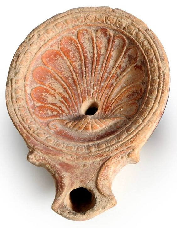 Roman oil lamp from the 1st century CE, decorated with a lovely shell.