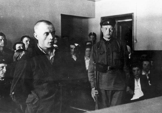 PURGE TRIAL, 1935. A man appearing before a popular tribunal in the Soviet Union during the Stalinist purges against alleged Trotskyists and political opponents, 1935.