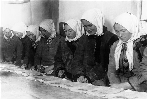 Farmers' wives from the rural districts of the Soviet Union in a class where they are taught to read and write in Russia around March 1931. (AP Photo)
